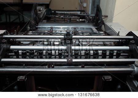 Offset printing machine in typography. Close-up photo