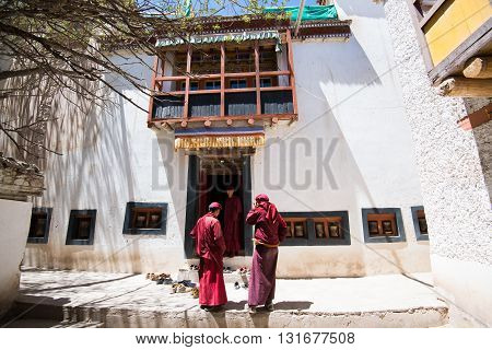 LADAKH, INDIA - MAY 1, 2016: Monks in Hemis monastery in Ladakh, Kashmir, India. Ladakh is sparsely populated regions in Jammu and Kashmir and its culture and history are related to that of Tibet.