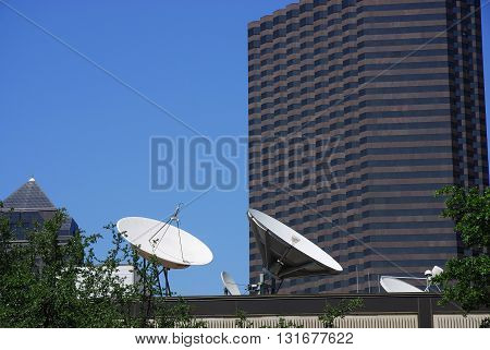 satellite communication dish on the roof of hotel building