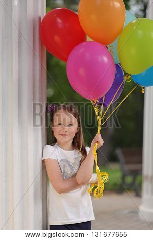 cute girl with balloon in park