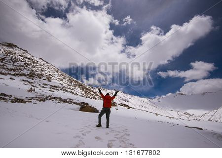 A man enjoy with beautiful landscape in Khardung la pass. Khardung la is the world's highest motorable pass.