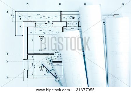 Architectural Blueprint Rolls With Plan And Drawing Compass