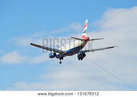 SAINT PETERSBURG, RUSSIA - MARCH 20, 2016: Flying Airbus A320-232 (G-EUYM) British Airways flies in a cloudy sky