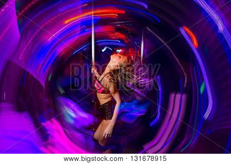 Young attractive woman dancing in night club