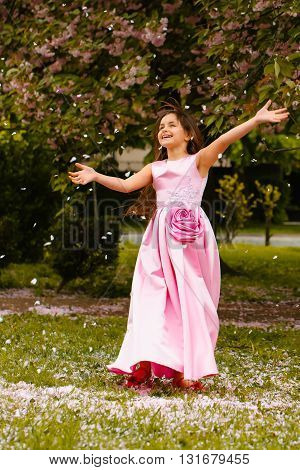 Little Girl In Pink Dress With Blossom