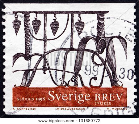 SWEDEN - CIRCA 1998: a stamp printed in the Sweden shows Wrought Iron Ornamental Designs circa 1998