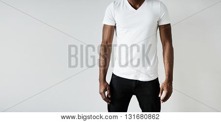 T-shirt Design And Advertising Concept. Cropped Portrait Of Black Male With Athlete Body Wearing Bla
