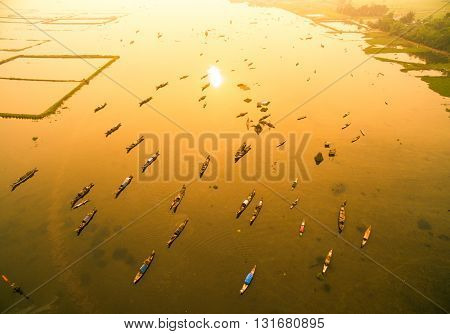 Boats in Tam Giang lagoon in sunrise from drone.Hue, Vietnam