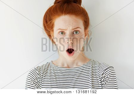Portrait Of Stunned Redhead Freckled Young Female Looking At The Camera With Shocked Expression, Mou