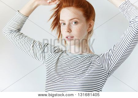 Cropped Shot Of Hipster Teenage Girl With Freckles Looking At The Camera With Coquettish Expression,