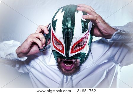 Headache, angry businessman with Mexican wrestler mask, expressions of anger and rage