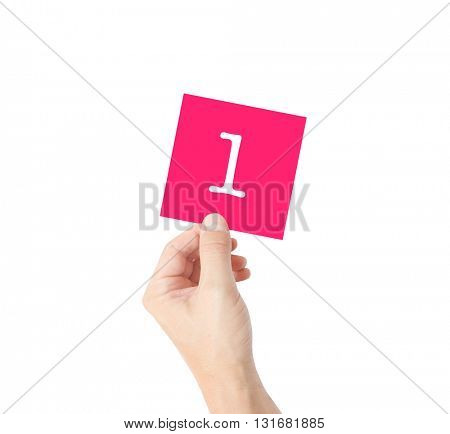 1 written on a card held by a hand
