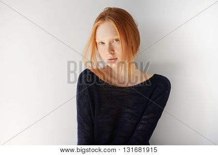People And Lifestyle Concept. Cute Young Female With Ginger Hair, Wearing Stylish Black Top, Looking