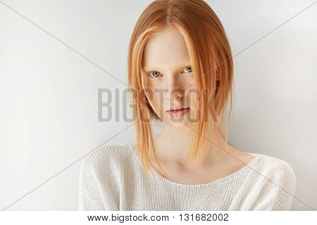 Close Up Portrait Of Beautiful Freckled Caucasian Teenage Girl With Red Hair And Blue Eyes Looking A