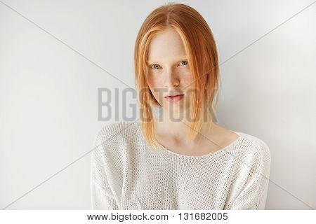 Beautiful Female Teenage Model Wearing Casual White Top Looking At The Camera With Thoughtful Expres