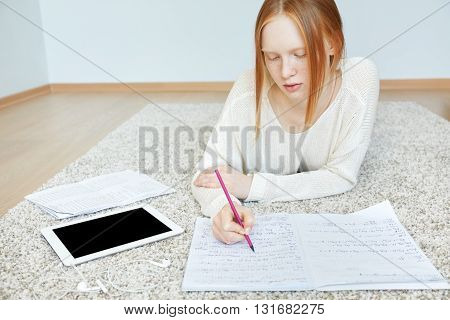 Close Up Shot Of Young Hardworking Woman With Pen In Her Hand Writing Something In Copybook While Ly