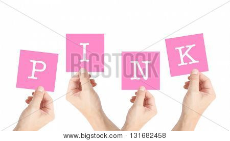 Pink written on cards held by hands