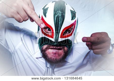 Shocked, angry businessman with Mexican wrestler mask, expressions of anger and rage