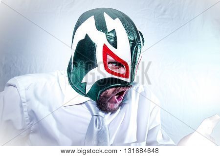 Stress, angry businessman with Mexican wrestler mask, expressions of anger and rage