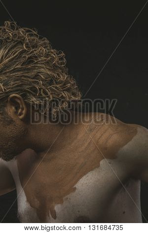 Muddy, covered with mud all over her naked body on black background man. adventure and risk, competition force
