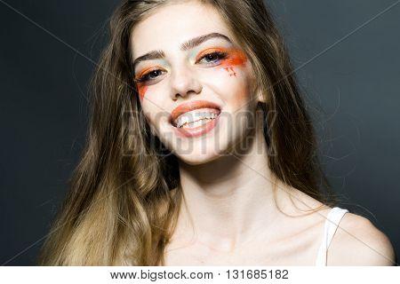 Girl With Orange Makeup Closeup