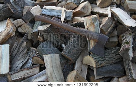 Old home axe handle hatchet on the chopped wood