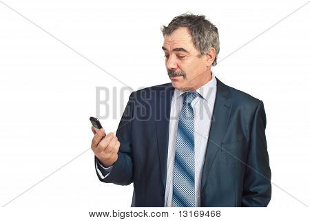 Surprised Mature Businessman Holding Cellphone