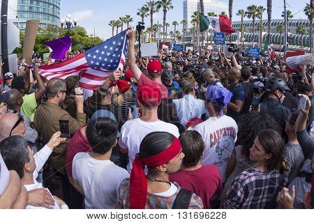 SAN DIEGO USA - MAY 27 2016: Tensions rise as anti-Trump protesters meet Trump supporters and American and Mexican flags are held up representing each group at a Donald Trump rally at the San Diego Convention Center.