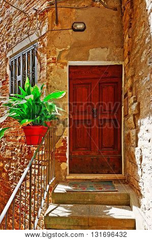 Porch Decorated with Flowers of the Old Buildings in Italian City