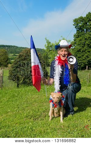 French soccer fan with his dog from les bleus in France