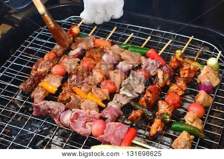 Barbecue on hot charcoal in the market