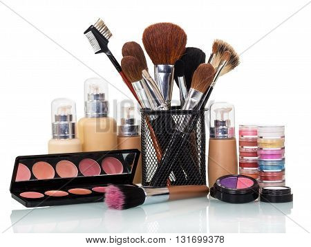Beauty, brush, eye shadow, liquid foundation and lip gloss isolated on white background.