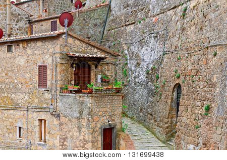 Narrow Street with Old Buildings in Italian City of Sorano