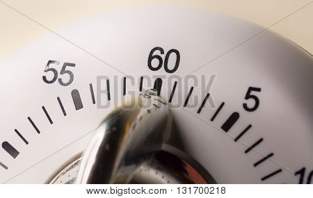 White Egg Timer Close Up with numbers.