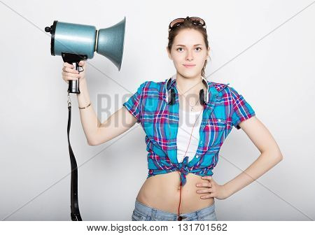 teenager girl in denim shorts and a plaid shirt express different emotions. counselor at a summer camp yelling through bullhorn.