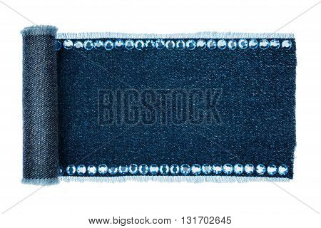 Frame made of denim in the form of a manuscript with blue rhinestones isolated on a white background