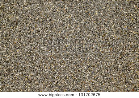 stone clad sidewalk, pebblestone sidewalk, Old Stone Country Road. Old Asphalt Road. Seamless Tileable Texture with Protruding Stones