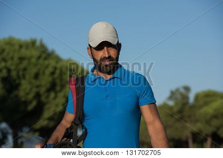 handsome middle eastern golfer portrait at golf course at sunny day