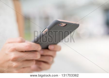 Woman watching on mobile phone