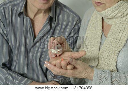 portrait of sick Elderly  couple  with pills