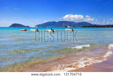 Motorboats On Blue Sea Near To The Sandy Beach In Summer Day