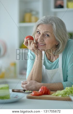 Portrait of a senior woman at kitchen