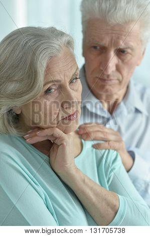 Portrait of a melancholy senior couple close up