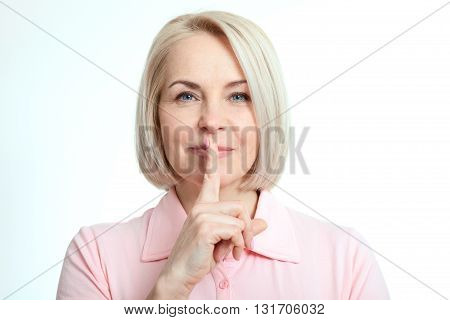 Portrait beautiful woman with finger on lips or secret gesture hand sign isolated on white background