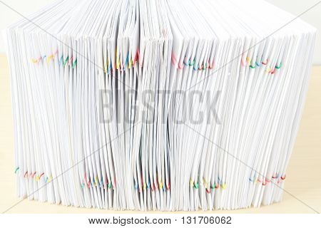 Pile Of Overload Paper Place In Vertical On Wooden Table