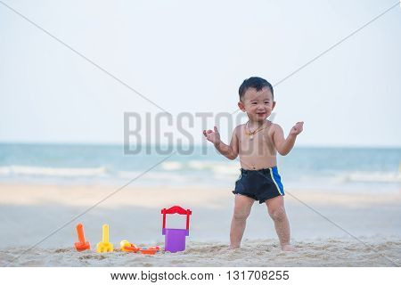 Little Asian Boy 1 Year Old Playing Sand On The Beach