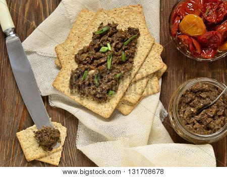 Mushroom pate and dried tomatoes with crackers mousse, top view