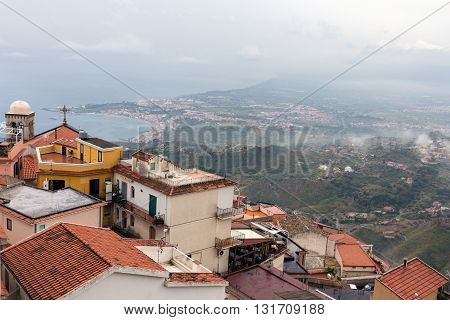 Panorama of Castelmola near Taormina and southward an aerial view at the Sicilian Coast with raining clouds