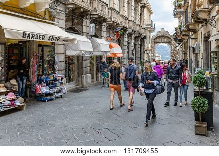 TAORMINA ITALY - MAY 21: Tourists shopping in the main street Corso Umberto of Taormina on May 21 2016 at the island Sicily Italy