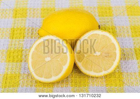 Sliced Yellow Lemon On Checkered Tablecloth
